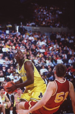 20 FEB 1993:  MICHIGAN FORWARD CHRIS WEBBER DRIVES HARD INTO A MINNESOTA DEFENDER DURING THE WOLVERINES GAME VERSUS TE GOLDEN GOPHERS AT CRISLER ARENA IN ANN ARBOR, MICHIGAN Mandatory Credit: Duane Burleson/ALLSPORT
