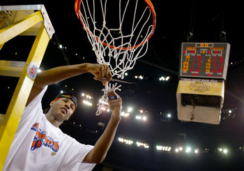 NEW ORLEANS - APRIL 7:  Carmelo Anthony #15 of Syracuse cuts down the net after he and his team defeated Kansas 81-78 during the championship game of the NCAA Men's Final Four Tournament on April 7, 2003 at the Louisiana Superdome in New Orleans, Louisian