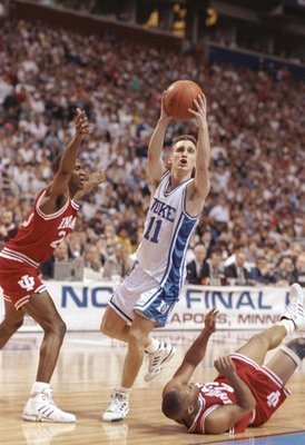 4 April 1992: Guard Bobby Hurley of the Duke Blue Devils drives between guard Greg Graham and Damon Bailey of the Indiana Hoosiers during a playoff game at the Hubert H. Humphrey Metrodome in Minneaspolis, Minnesota. Duke won the game 81-78.