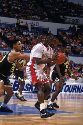 MARCH - 1991:  Larry Johnson #4 of the University of Las Vegas Nevada Rebels looks to make a move during an NCAA game against Cal State Long Beach in March of 1991.  (Photo by Ken Levine/Getty Images)