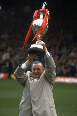 1983:  Bob Paisley Manager of Liverpool holds aloft the League Championship trophy after the final League game at Anfield in Liverpool, England. \ Mandatory Credit: Mike  Powell/Allsport