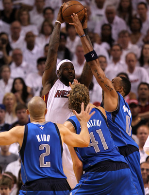 MIAMI, FL - JUNE 12:  LeBron James #6 of the Miami Heat passes the ball against Jason Kidd #2, Dirk Nowitzki #41 and Shawn Marion #0 of the Dallas Mavericks in Game Six of the 2011 NBA Finals at American Airlines Arena on June 12, 2011 in Miami, Florida.