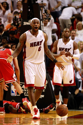 MIAMI, FL - MAY 24:  LeBron James #6 of the Miami Heat reacts against the Chicago Bulls in Game Four of the Eastern Conference Finals during the 2011 NBA Playoffs on May 24, 2011 at American Airlines Arena in Miami, Florida. The Heat won 101-93 in overtim