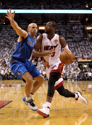 MIAMI, FL - JUNE 12:  Dwyane Wade #3 of the Miami Heat drives against Jason Kidd #2 of the Dallas Mavericks in Game Six of the 2011 NBA Finals at American Airlines Arena on June 12, 2011 in Miami, Florida. NOTE TO USER: User expressly acknowledges and agr