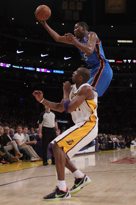 LOS ANGELES, CA - APRIL 10:  Kevin Durant #35 of the Oklahoma City Thunder rebounds a ball over Kobe Bryant #24 of the Los Angeles Lakers in the first half at Staples Center on April 10, 2011 in Los Angeles, California. The Thunder defeated the Lakers 120