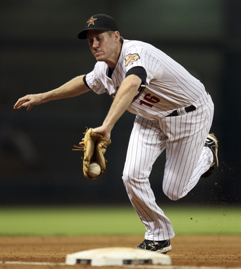 HOUSTON - JUNE 29:  Third baseman Matt Downs #16 of the Houston Astros snags a ground ball hit hard down the line by Colby Lewis of the Texas Rangers at Minute Maid Park on June 29, 2011 in Houston, Texas.  (Photo by Bob Levey/Getty Images)