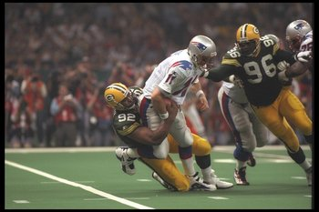 26 Jan 1997:  Defensive end Reggie White #92 of the Green Bay Packers sacks quarterback Drew Bledsoe #11 of the New England Patriots during the 3rd quarter of Super Bowl XXXI at the Louisiana Superdome in New Orleans, Louisiana.   Mandatory Credit: Doug P