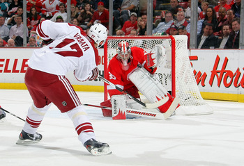DETROIT, MI - APRIL 13:  Radim Vrbata #17 of the Phoenix Coyotes is stopped by Jimmy Howard #35 of the Detroit Red Wings as they play in Game One of the Western Conference Quarterfinals during the 2011 NHL Stanley Cup Playoffs at at Joe Louis Arena on Apr