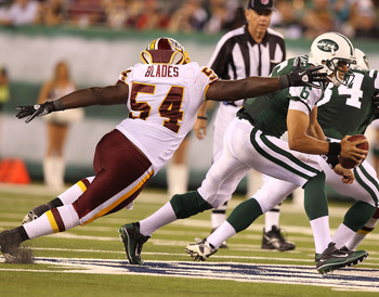EAST RUTHERFORD, NJ - AUGUST 27:  Mark Sanchez #6 of the New York Jets eludes H.B. Blades #54 of the Washington Redskins  during their preseason game on August 27, 2010 at the New Meadowlands Stadium  in East Rutherford, New Jersey.  (Photo by Al Bello/Ge