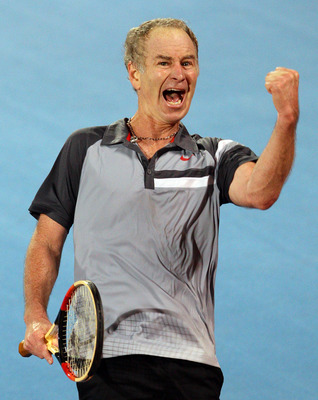 SYDNEY, AUSTRALIA - NOVEMBER 13:  John McEnroe celebrates during his match against Mats Wilander during day three of the Sydney Champions Downunder at Sydney Olympic Park Tennis Centre on November 13, 2010 in Sydney, Australia. (Photo by Craig Golding/Get