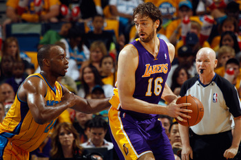 NEW ORLEANS, LA - APRIL 22:  Pau Gasol #16 of the Los Angeles Lakers drives the ball around Carl Landry #24 of the New Orleans Hornets in Game Three of the Western Conference Quarterfinals in the 2011 NBA Playoffs at the New Orleans Arena  on April 22, 20