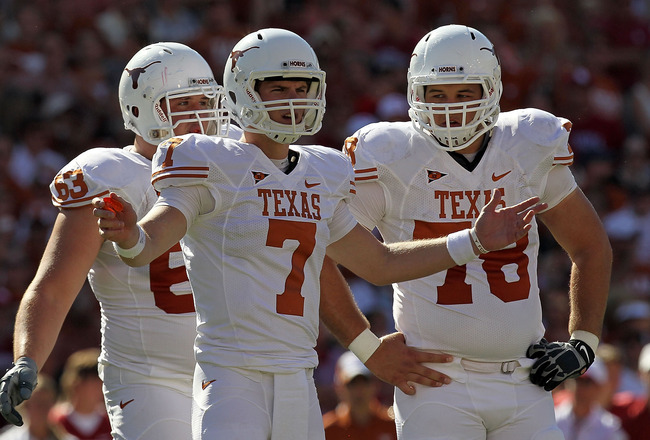 DALLAS - OCTOBER 02:  Quarterback Garrett Gilbert #7 of the Texas Longhorns reacts during play against the Oklahoma Sooners at the Cotton Bowl on October 2, 2010 in Dallas, Texas.  (Photo by Ronald Martinez/Getty Images)