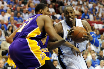 ORLANDO, FL - JUNE 14:  Dwight Howard #12 of the Orlando Magic drives on Andrew Bynum #17 of the Los Angeles Lakers in the third quarter of Game Five of the 2009 NBA Finals on June 14, 2009 at Amway Arena in Orlando, Florida.  NOTE TO USER:  User expressl
