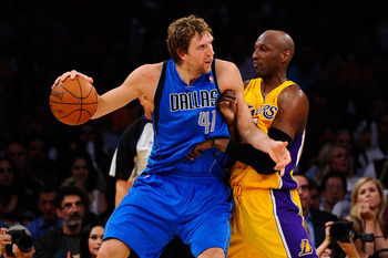 LOS ANGELES, CA - MAY 04:  Dirk Nowitzki #41 of the Dallas Mavericks posts up Lamar Odom #7 of the Los Angeles Lakers in the second half in Game Two of the Western Conference Semifinals in the 2011 NBA Playoffs at Staples Center on May 4, 2011 in Los Ange