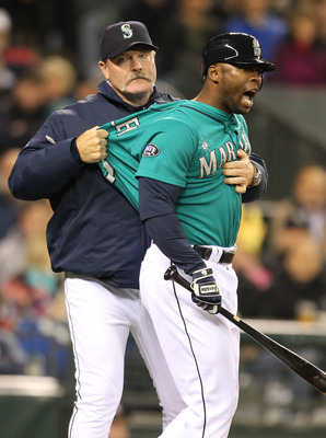 SEATTLE - FILE:  Milton Bradley #15 of the Seattle Mariners is restrained by manager Eric Wedge #22 after being ejected from the game against the Chicago White Sox at Safeco Field on May 6, 2011 in Seattle, Washington. According to reports May 9, 201, Bra