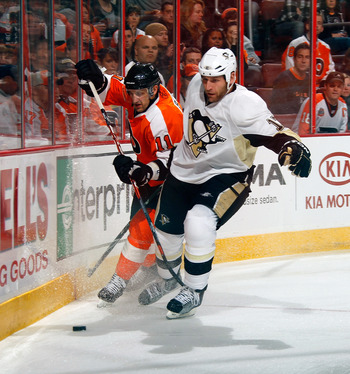 PHILADELPHIA, PA - MARCH 24:  Mike Rupp #17 of the Pittsburgh Penguins and Blair Betts #11 of the Philadelphia Flyers skate for the puck during a game on March 24, 2011 at the Wells Fargo Center in Philadelphia, Pennsylvania.  (Photo by Lou Capozzola/Gett