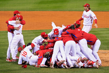 PHILADELPHIA - OCTOBER 29:  The Philadelphia Phillies pile on top of closing pitcher Brad Lidge #54 after they won 4-3 to win the World Series against the Tampa Bay Rays during the continuation of game five of the 2008 MLB World Series on October 29, 2008