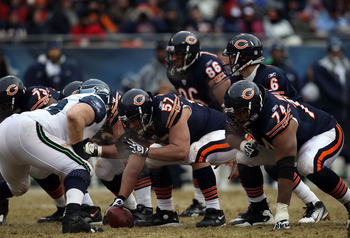 CHICAGO, IL - JANUARY 16:  Center Olin Kreutz #57 of the Chicago Bears prepares to hike the football against the Seattle Seahawks in the 2011 NFC divisional playoff game at Soldier Field on January 16, 2011 in Chicago, Illinois.  (Photo by Jonathan Daniel