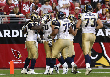 GLENDALE, AZ - DECEMBER 05:  Runningback Steven Jackson #39 of the St. Louis Rams celebrates with teammates after scoring a 27 yard rushing touchdown against the Arizona Cardinals during the third quarter of the NFL game at the University of Phoenix Stadi