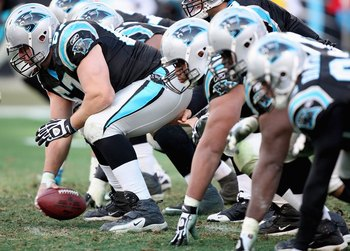 CHARLOTTE, NC - JANUARY 03:  Center Ryan Kalil #67 of the Carolina Panthers leads the offensive line during the game against the New Orleans Saints at Bank of America Stadium on January 3, 2010 in Charlotte, North Carolina.  (Photo by Streeter Lecka/Getty