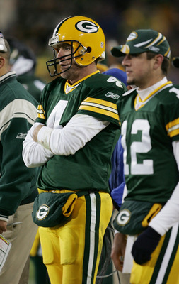 GREEN BAY, WI - NOVEMBER 6:  Quarterbacks Brett Favre #4 and Aaron Rodgers #12 of the Green Bay Packers watch the final minutes of a game against the Pittsburgh Steelers from the sideline November 6, 2005 at Lambeau Field in Green Bay, Wisconsin. The Stee