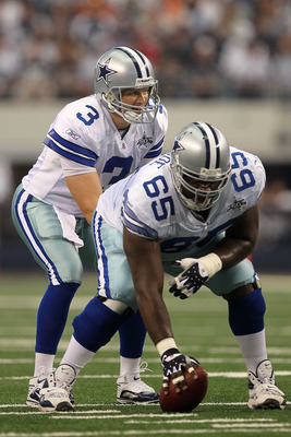 ARLINGTON, TX - OCTOBER 31:  Quarterback Jon Kitna #3 of the Dallas Cowboys calls signals at the line of scrimmage as he stands under center Andre Gurode #65 against the Jacksonville Jaguars at Cowboys Stadium on October 31, 2010 in Arlington, Texas.  (Ph