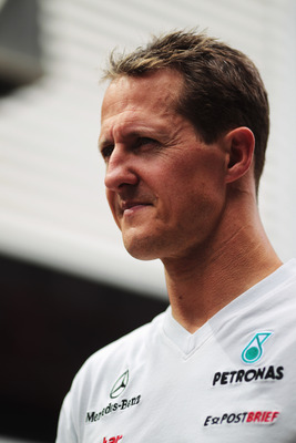 VALENCIA, SPAIN - JUNE 24:  Michael Schumacher of Germany and Mercedes GP walks in the paddock following practice for the European Formula One Grand Prix at the Valencia Street Circuit on July 24, 2011, in Valencia, Spain.  (Photo by Paul Gilham/Getty Ima