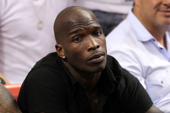 MIAMI, FL - MAY 24:  Chad 'Ochocinco' Johnson watches the Miami Heat play against the Chicago Bulls in Game Four of the Eastern Conference Finals during the 2011 NBA Playoffs on May 24, 2011 at American Airlines Arena in Miami, Florida. NOTE TO USER: User