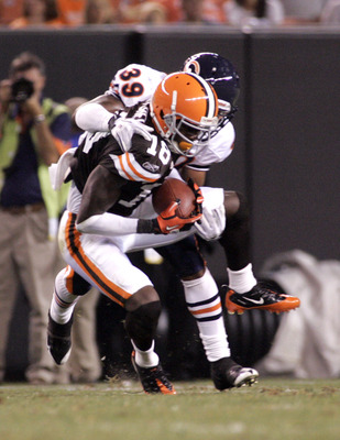 CLEVELAND - SEPTEMBER 2:  Carlton Mitchell #18 of the Cleveland Browns pulls in a catch against Cornelius Brown #39 of the Chicago Bears during the preseason game on September 2, 2010 at Cleveland Browns Stadium in Cleveland, Ohio. The Browns defeated the