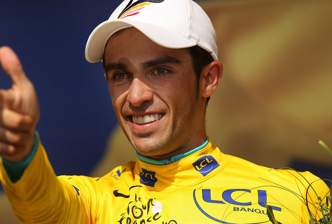 PAUILLAC, FRANCE - JULY 24:  Race leader Alberto Contador of team Astana stands on the podium in the yellow jersey following stage 19 of the Tour de France on July 24, 2010 in Pauillac, France. The only time-trial stage of this years race, the 52km cours