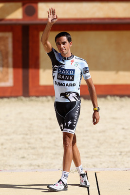 LES HERBIERS, FRANCE - JUNE 30:  Alberto Contador of Spain and the Saxobank Sungard team waves to the crowd during the official team presentations at Puy du Fou on June 30, 2011 in Les Herbiers, France.  (Photo by Michael Steele/Getty Images)