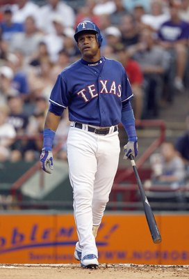 ARLINGTON, TX - JUNE 24: Sammy Sosa #21 of the Texas Rangers walks with his bat against the Houston Astros on June 24, 2007 at the Rangers Ballpark in Arlington, Texas. The Astros won 12-9. (Photo by Layne Murdoch/Getty Images).
