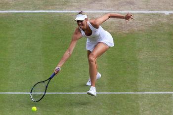LONDON, ENGLAND - JUNE 30:  Maria Sharapova of Russia returns a shot during her semifinal round match against  Sabine Lisicki of Germany on Day Ten of the Wimbledon Lawn Tennis Championships at the All England Lawn Tennis and Croquet Club on June 30, 2011