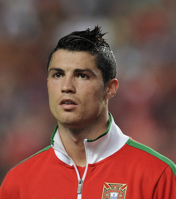 LISBON, PORTUGAL - JUNE 04:  Cristiano Ronaldo of Portugal lines up before the start of the EURO 2012 Group H qualifier between Portugal and Norway at Estadio do Sport Lisboa e Benfica on June 4, 2011 in Lisbon, Portugal.  (Photo by Denis Doyle/Getty Imag