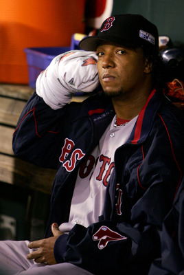 ST LOUIS - OCTOBER 26:  Starting pitcher Pedro Martinez #45 of the Boston Red Sox rests in between innings against the St. Louis Cardinals during game three of the World Series on October 26, 2004 at Busch Stadium in St. Louis, Missouri. (Photo by Al Bell