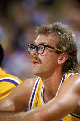 LOS ANGELES - 1988:  Kurt Rambis #31 of the Los Angeles Lakers sits on the bench during an NBA game at the Great Western Forum in Los Angeles, California in 1988. (Photo by Mike Powell/Getty Images)