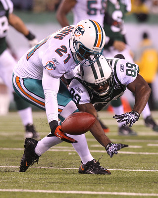 EAST RUTHERFORD, NJ - DECEMBER 12: Jerricho Cotchery #89 of the New York Jets has a pass broken up by Vontae Davis #21 of the Miami Dolphins at New Meadowlands Stadium on December 12, 2010 in East Rutherford, New Jersey.  (Photo by Nick Laham/Getty Images