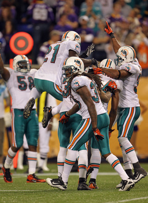 MINNEAPOLIS - SEPTEMBER 19:  The Miami Dolphins defense celebrates after stopping a drive by the Minnesota Vikings late in the 4th quarter during the game on September 19, 2010 at Hubert H. Humphrey Metrodome in Minneapolis, Minnesota.  (Photo by Jamie Sq
