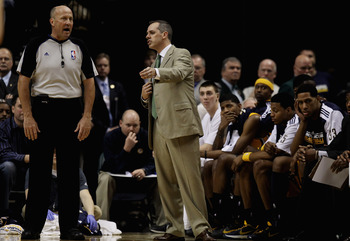 INDIANAPOLIS, IN - APRIL 23: Head coach Frank Vogel of the Indiana Pacers talks with referee David Jones #36 in Game Four of the Eastern Conference Quarterfinals in the 2011 NBA Playoffs against the Chicago Bulls at Conseco Fieldhouse on April 23, 2011 in