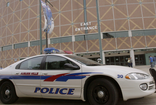 AUBURN HILLS - MAY 9:  An Auburn Hills police car drives by the front of the Palace before the game between the Indiana Pacers and the Detroit Pistons in Game one of the Eastern Conference Semifinals during the 2005 NBA Playoffs on May 9, 2005 in Auburn H