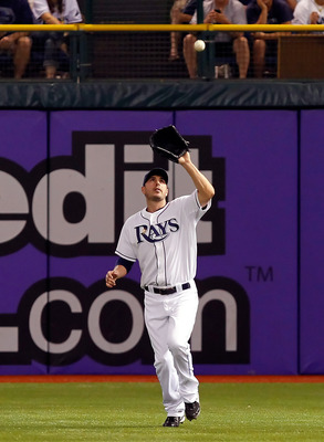 ST. PETERSBURG, FL - JUNE 28:  Outfielder Matt Joyce #20 of the Tampa Bay Rays catches a fly ball against the Cincinnati Reds during the game at Tropicana Field on June 28, 2011 in St. Petersburg, Florida.  (Photo by J. Meric/Getty Images)