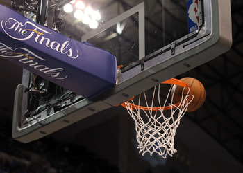 DALLAS, TX - JUNE 05:  The ball sits above the rim in Game Three of the 2011 NBA Finals between the Dallas Mavericks and the Miami Heat at American Airlines Center on June 5, 2011 in Dallas, Texas.  NOTE TO USER: User expressly acknowledges and agrees tha