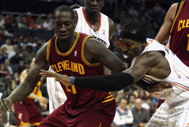 CHARLOTTE, NC - DECEMBER 29:  J.J. Hickson #21 of the Cleveland Cavaliers battles for a loose ball with Gerald Wallace #3 of the Charlotte Bobcats during their game at Time Warner Cable Arena on December 29, 2010 in Charlotte, North Carolina. NOTE TO USER