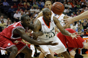 CHARLOTTE, NC - MARCH 13:  Anthony King #50 of the Miami Hurricanes and J.J. Hickson #1 of the North Carolina Wolfpack battle for a loose ball during Day 1 of the 2008 Men's ACC Basketball Tournament at Bobcats Arena on March 13, 2008 in Charlotte, North
