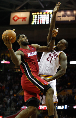CLEVELAND - MARCH 29:  LeBron James #6 of the Miami Heat drives to the basket during the game against J. J. Hickson #21 of the Cleveland Cavaliers on March 29, 2011 at Quicken Loans Arena in Cleveland, Ohio. NOTE TO USER: User expressly acknowledges and a