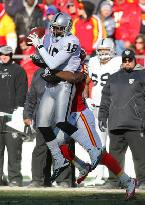 KANSAS CITY, MO - JANUARY 02:  Wide receiver Louis Murphy #18 of the Oakland Raiders is tackled as he catches the ball in a game against the Kansas City Chiefs at Arrowhead Stadium on January 2, 2011 in Kansas City, Missouri.  (Photo by Tim Umphrey/Getty