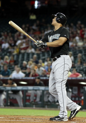 PHOENIX, AZ - JUNE 01:  Mike Stanton #27 of the Florida Marlins hits a two run home run against the Arizona Diamondbacks during the second inning of the Major League Baseball game at Chase Field on June 1, 2011 in Phoenix, Arizona.  (Photo by Christian Pe