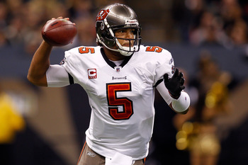 NEW ORLEANS, LA - JANUARY 02:  Quarterback Josh Freeman #5  of the Tampa Bay Buccaneers throws the ball during the game against the New Orleans Saints at the Louisiana Superdome on January 2, 2011 in New Orleans, Louisiana.  (Photo by Chris Graythen/Getty