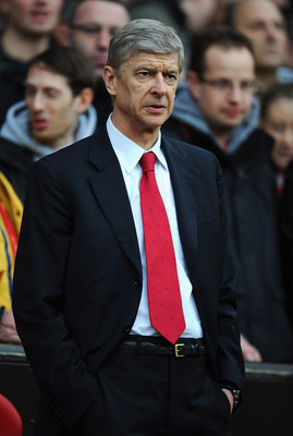 MANCHESTER, ENGLAND - MARCH 12:  Arsenal manager Arsene Wenger looks on ahead of the FA Cup sponsored by E.On Sixth Round match between Manchester United and Arsenal at Old Trafford on March 12, 2011 in Manchester, England.  (Photo by Clive Mason/Getty Im