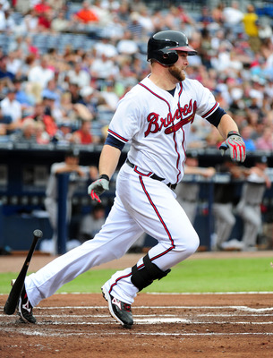ATLANTA - JUNE 21: Brian McCann #16 of the Atlanta Braves hits against the Toronto Blue Jays at Turner Field on June 21, 2011 in Atlanta, Georgia. (Photo by Scott Cunningham/Getty Images)